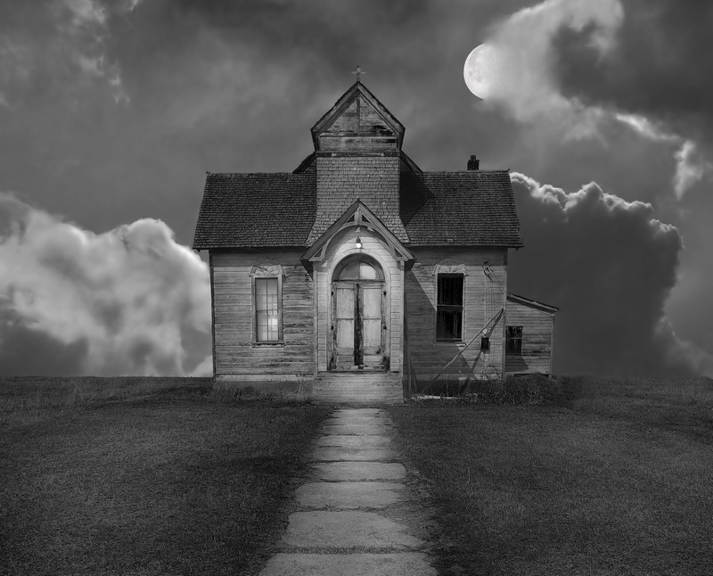 The moon casts eerie light on the ruins of a chapel on the plains.